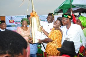 At last the long-awaited Gong has come! Mrs. Payeboye Festus-Lukah, Acting Executive Director, Bayelsa State Council for Arts and Culture Overall Winner of NAFEST 2016 receiving the NAFEST 2016 Presidential Gong presented to Bayelsa State by the Executive Governor of Akwa-Ibom ably represented by Hon. Otuekong Ibiok, Hon. Commissioner for Culture and Tourism, Akwa-Ibom State at the Official Closing Ceremony held on Saturday 8th October, 2016 at the Uyo Township Stadium Uyo, Akwa-Ibom State